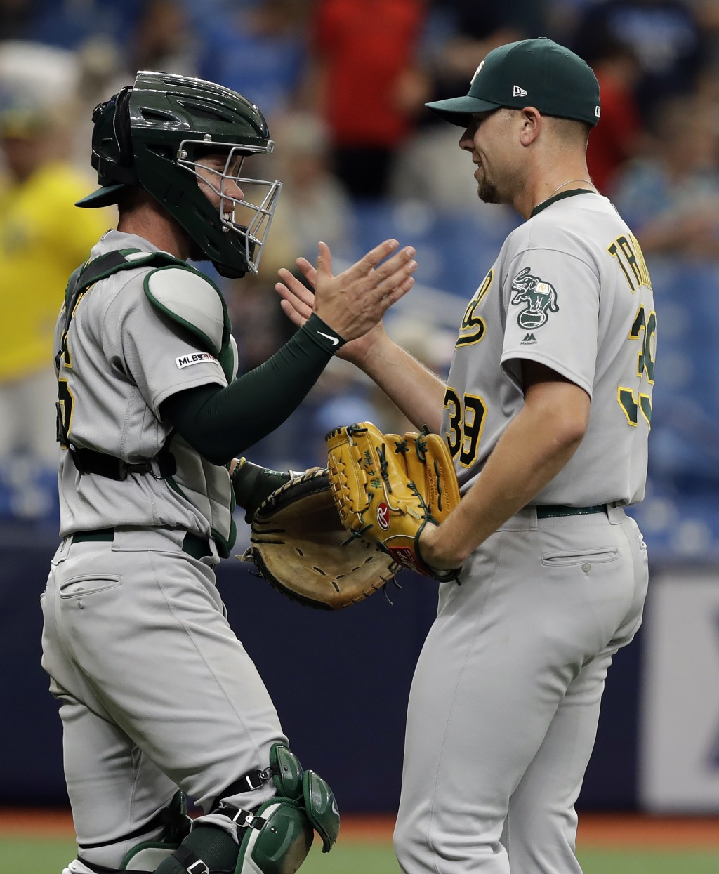 Oakland Athletics relief pitcher Blake Treinen, right, and catcher Beau Taylor celebrate after the team defeated the Tampa Bay Rays during a baseball
