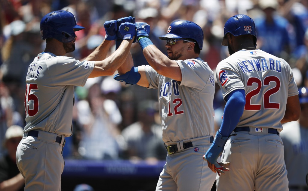 From left, Chicago Cubs' Cole Hamels congratulates Kyle Schwarber as he crosses home plate after connecting for a three-run home run as Jason Heyward ...