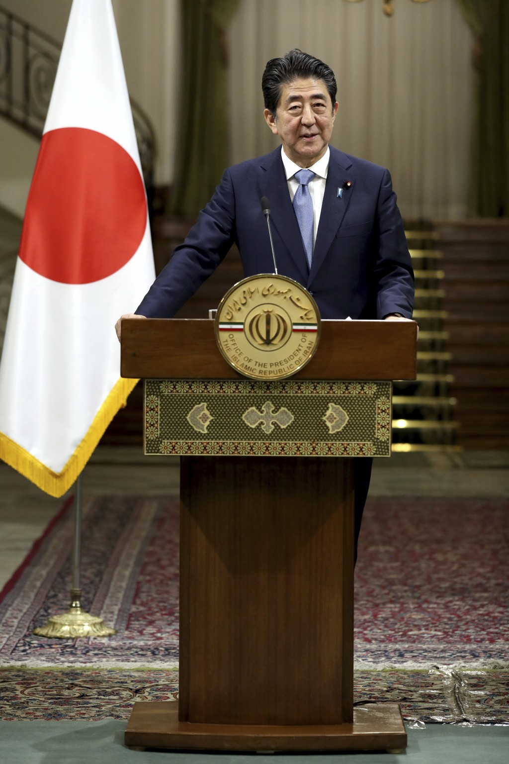 Japanese Prime Minister Shinzo Abe speaks with media during a joint press conference with Iranian President Hassan Rouhani, after their meeting at the