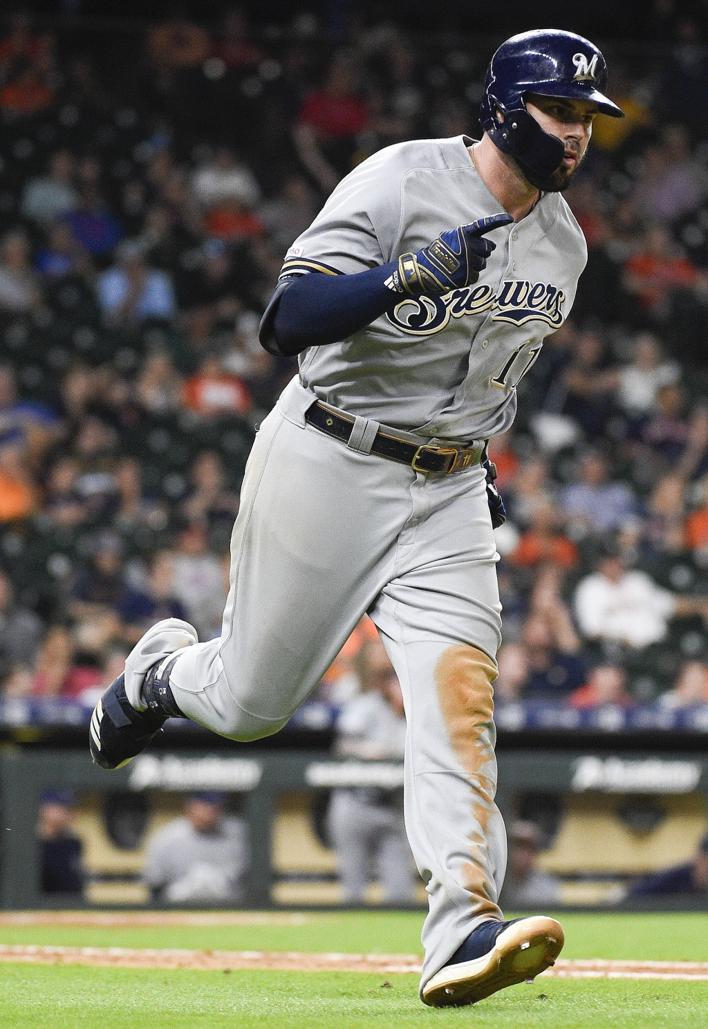 Milwaukee Brewers' Mike Moustakas runs the bases a...