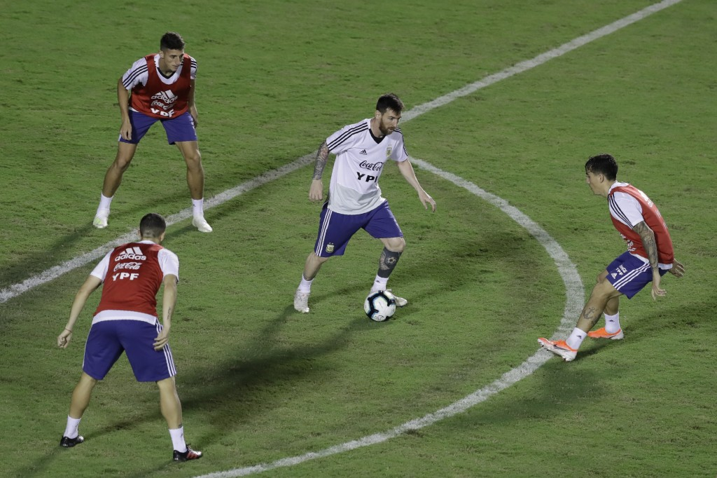 Argentina's Lionel Messi, right, controls the ball during a training session of the national soccer team at Barradao stadium, in preparation for the C