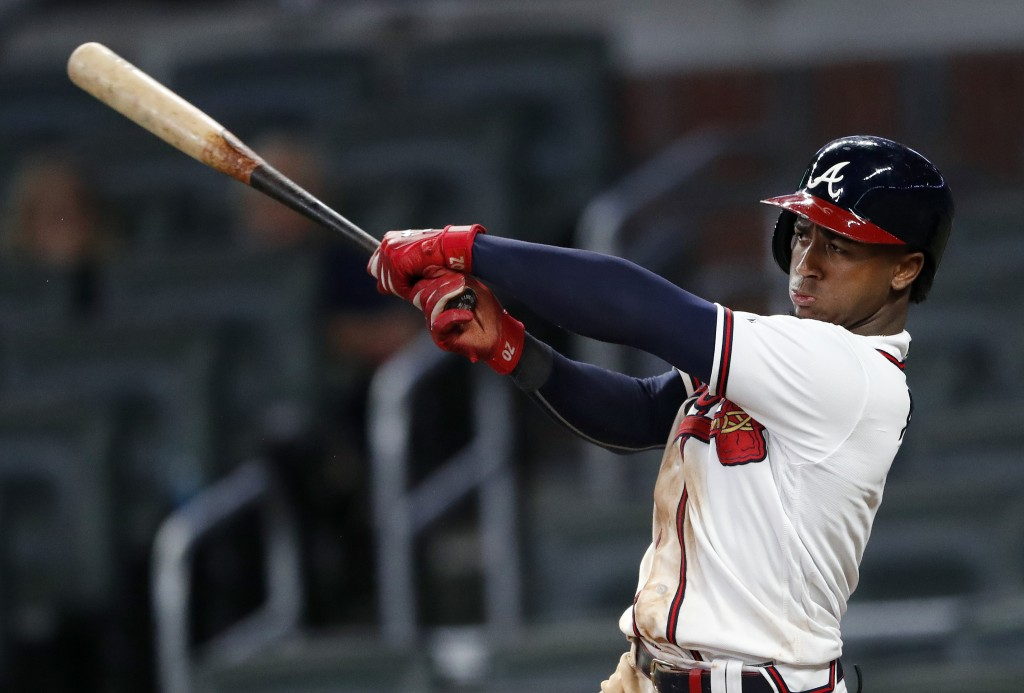 Atlanta Braves' Ozzie Albies drives in the winning run with a double in the 11th inning of the team's baseball game against the Pittsburgh Pirates ear...