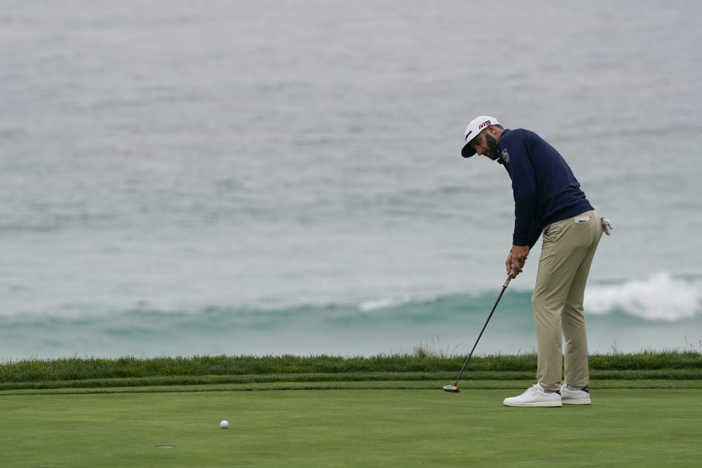Dustin Johnson putts on the 10th hole during a practice round for the U.S. Open Championship golf tournament Wednesday, June 12, 2019, in Pebble Beach