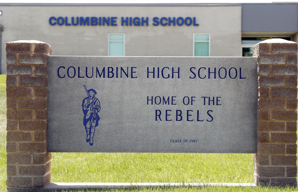 Signs outside Columbine High School are photographed, Thursday, June 13, 2019, in Littleton, Colo. The school district is considering the demolition o