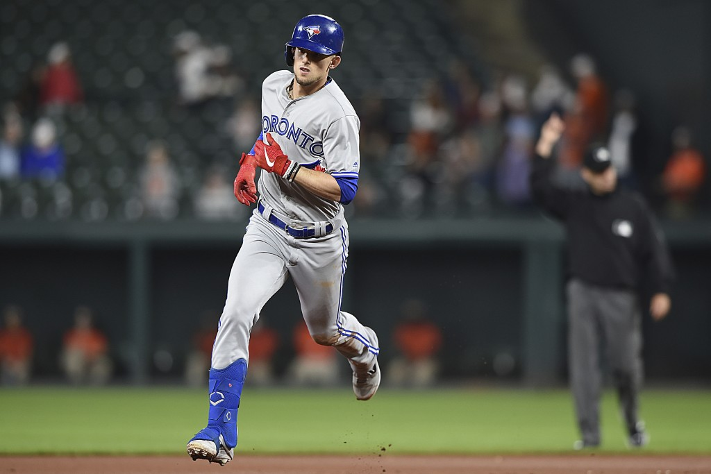 Toronto Blue Jays' Cavan Biggio runs the bases after hitting a solo home run against the Baltimore Orioles during the seventh inning of a baseball gam