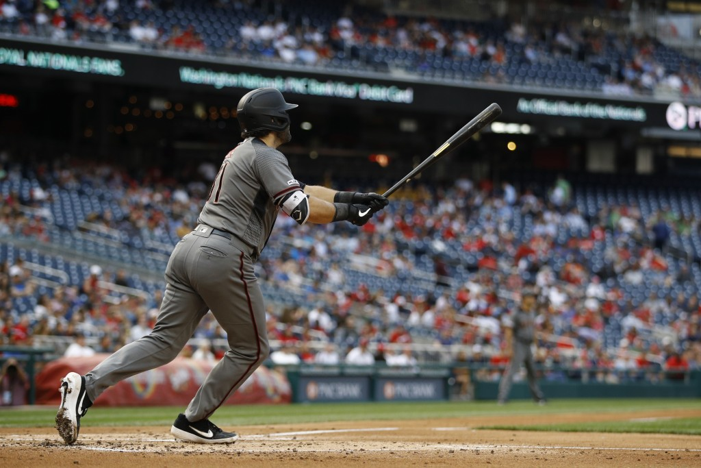 Arizona Diamondbacks' Alex Avila watches his solo home run during the second inning of the team's baseball game against the Washington Nationals, Thur...
