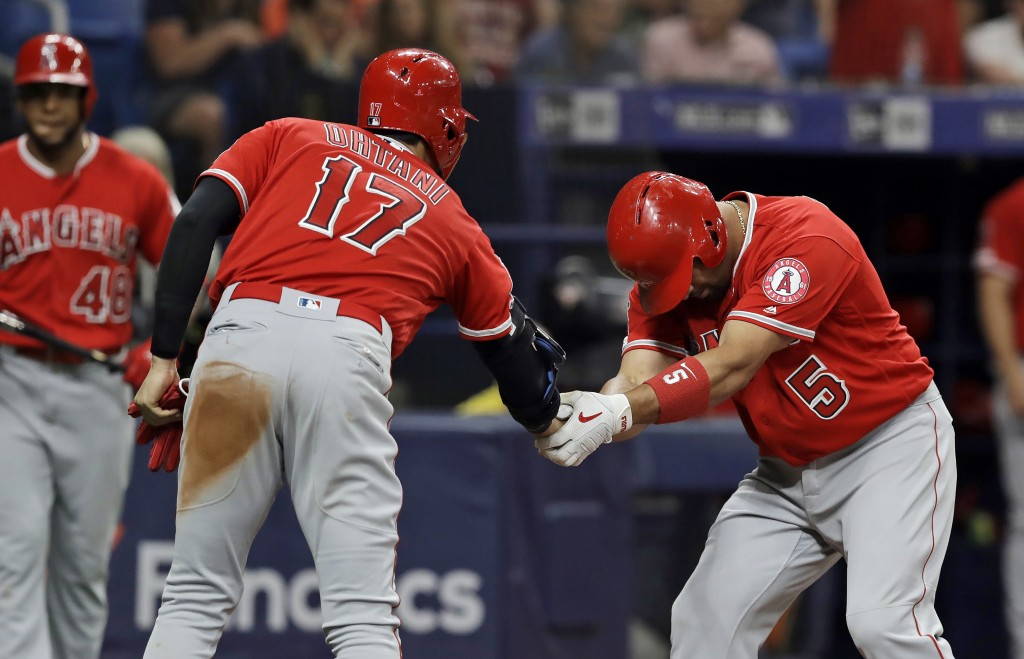 Los Angeles Angels' Albert Pujols (5) bows as he shakes hands with Shohei Ohtani (17), of Japan, after Pujols hit a two-run home run off Tampa Bay Ray