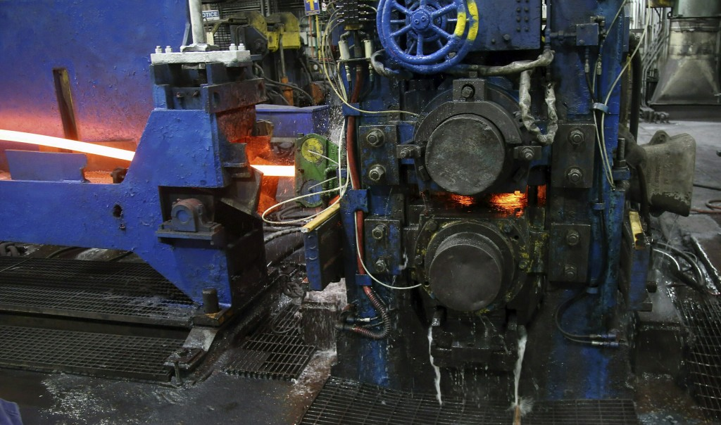 FILE - In this May 9, 2019, file photo, molten steel to make steel rods moves through the production line at the Gerdau Ameristeel mill in St. Paul, M...