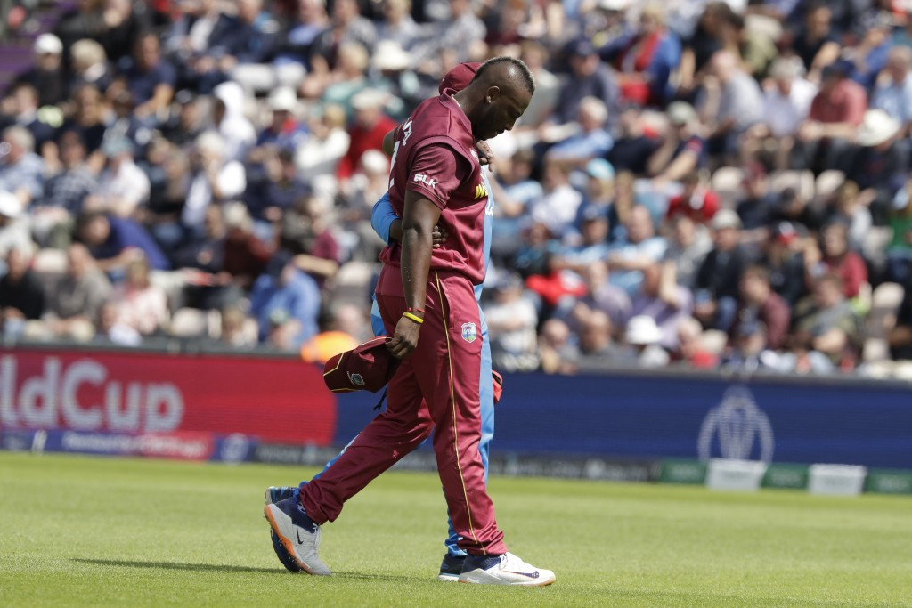 West Indies' Andre Russell walks off the field of play with an injury after bowling during the Cricket World Cup match between England and West Indies...