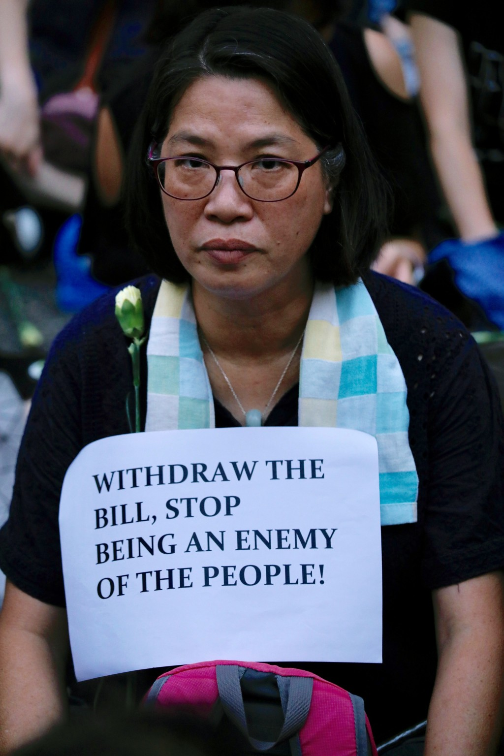 A woman joins hundreds of mothers protesting against the amendments to the extradition law after Wednesday's violent protest in Hong Kong on Friday, J