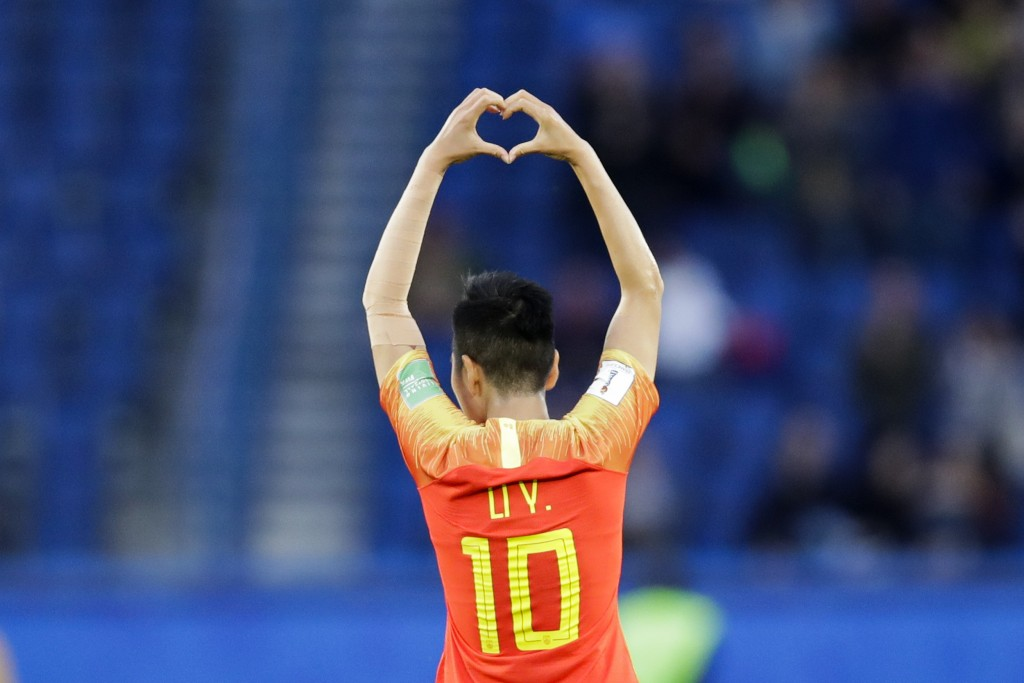 China's Li Ying celebrates after scoring the opening goal during the Women's World Cup Group B soccer match between China and South Africa at Parc des