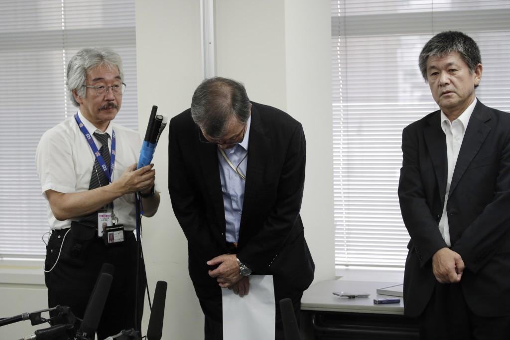 Yutaka Katada, center, president of Kokuka Sangyo Co., the Japanese company operating one of two oil tankers attacked near the Strait of Hormuz, bows