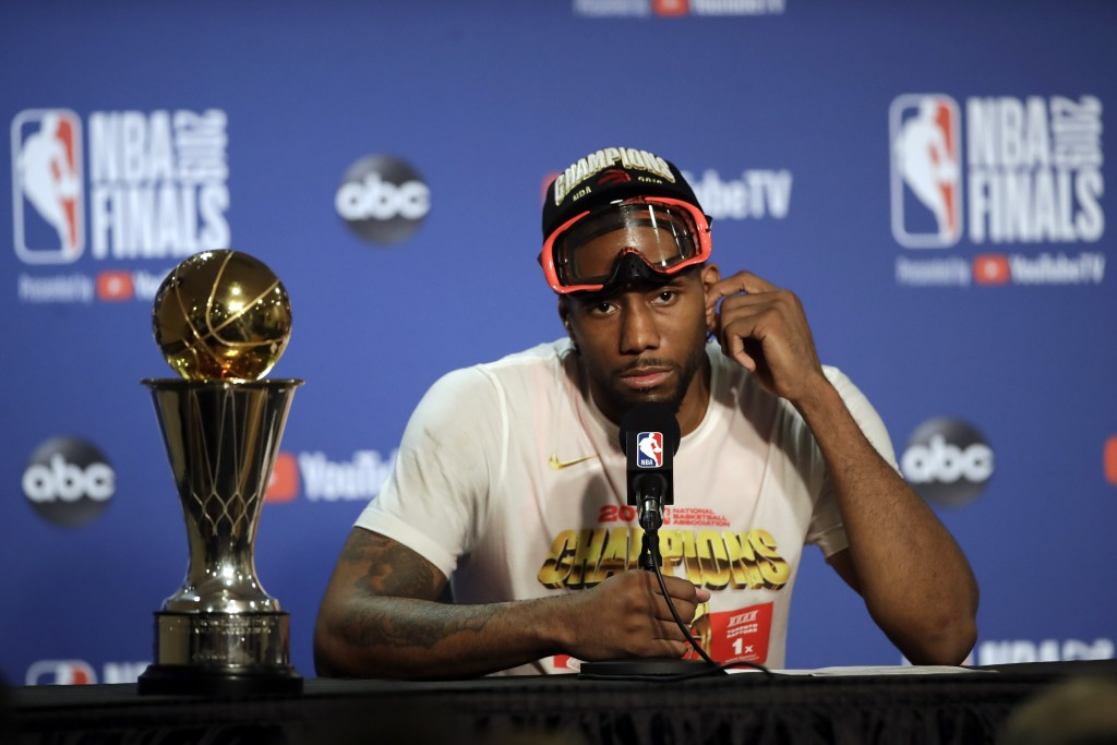 Toronto Raptors forward Kawhi Leonard speaks at a news conference alongside the NBA Finals Most Valuable Player trophy after the Raptors defeated the ...