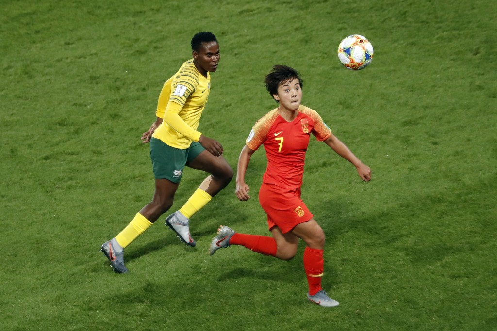 China's Wang Shuang, right, challenges for the ball with South Africa's Noko Matlou, left, during the Women's World Cup Group B soccer match between C...