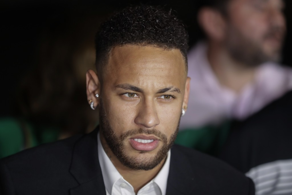 FILE - In this June 13, 2019 file photo, Brazil's soccer player Neymar speaks to the press as he leaves a police station where he answered questions a...