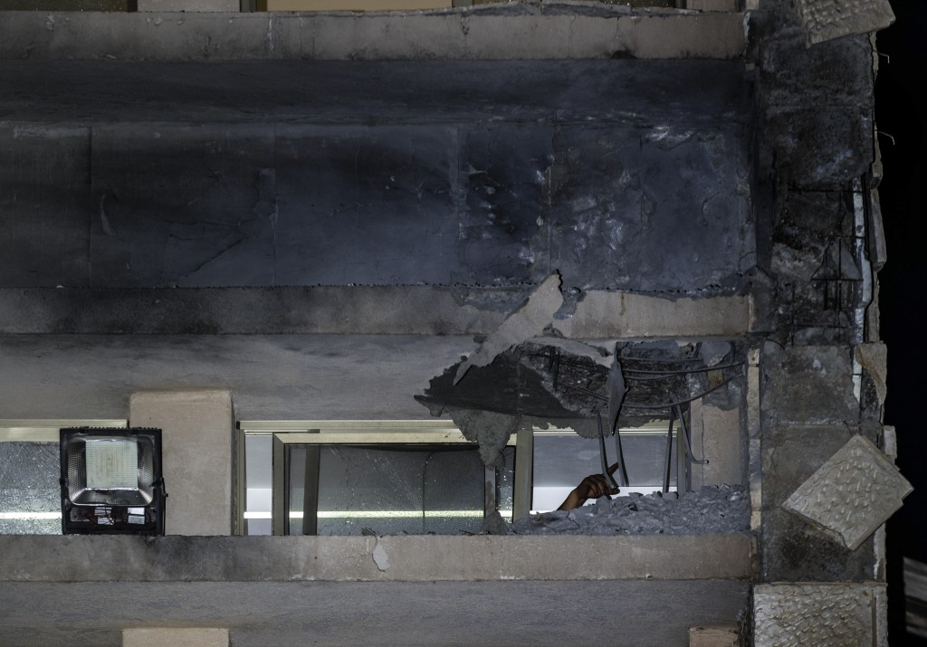 A damage to a Jewish religious school is seen in Sderot, Israel, after it was hit by a rocket fired from the Gaza Strip, Thursday, June 13, 2019. (AP