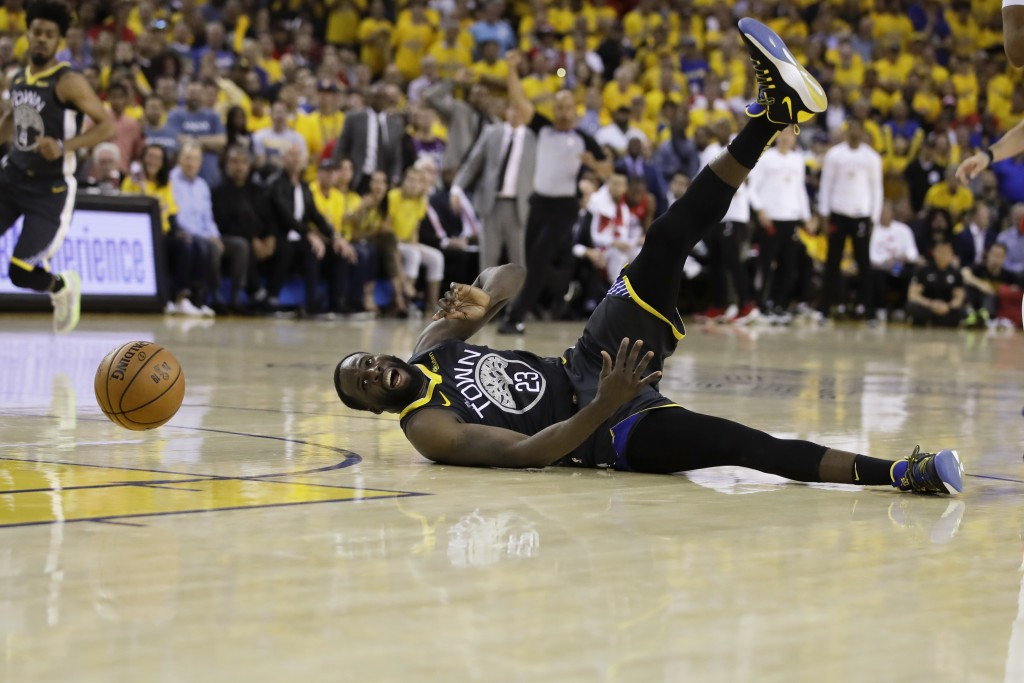Golden State Warriors forward Draymond Green loses the ball during the second half against the Toronto Raptors in Game 6 of basketball's NBA Finals, T