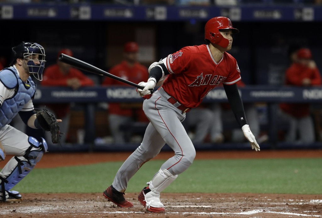 Los Angeles Angels' Shohei Ohtani, of Japan, watches his triple off Tampa Bay Rays' Ryan Yarbrough during the fifth inning of a baseball game Thursday