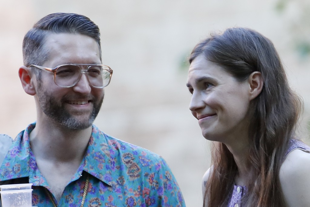 Amanda Knox, right, and her boyfriend Christopher Robinson attend a cocktail for the opening of the Innocence Project conference, in Modena, Italy, Th