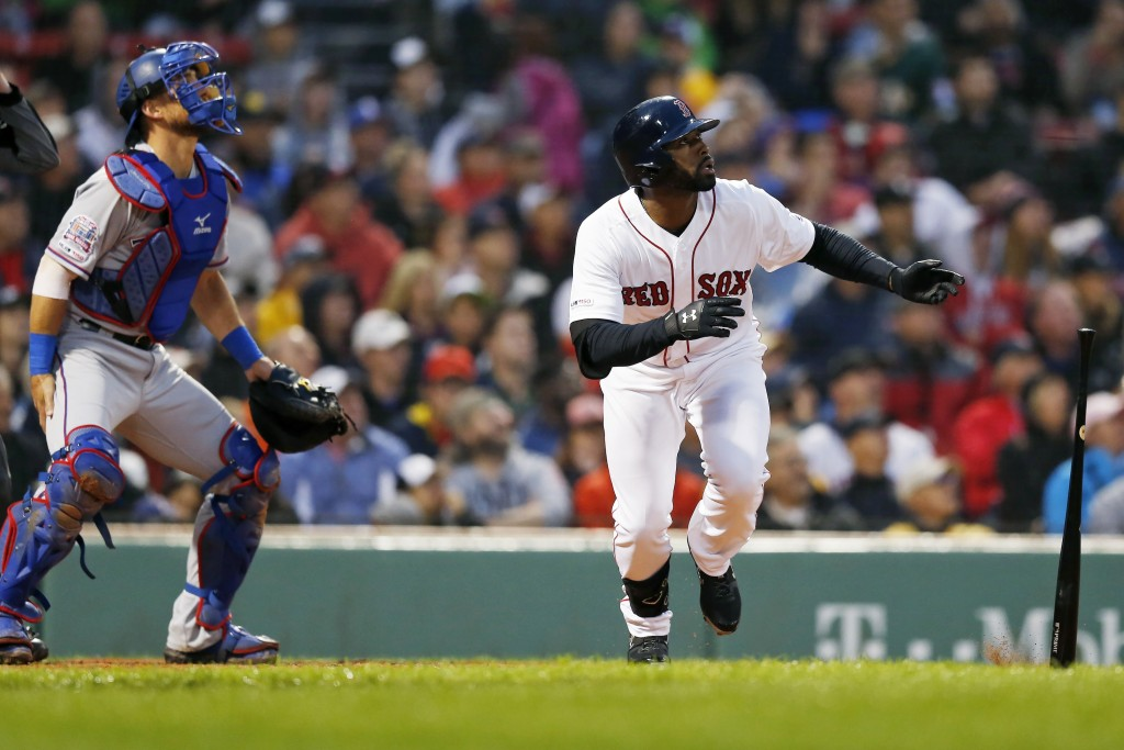 Boston Red Sox's Jackie Bradley Jr. watches his three-run home run in front of Texas Rangers catcher Jeff Mathis during the second inning of a basebal