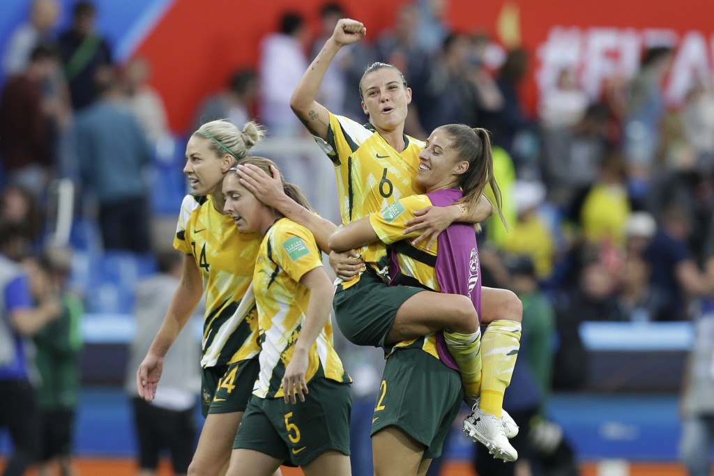Australia's Chloe Logarzo, top, celebrates with a teammate at the end of the Women's World Cup Group C soccer match between Australia and Brazil at St