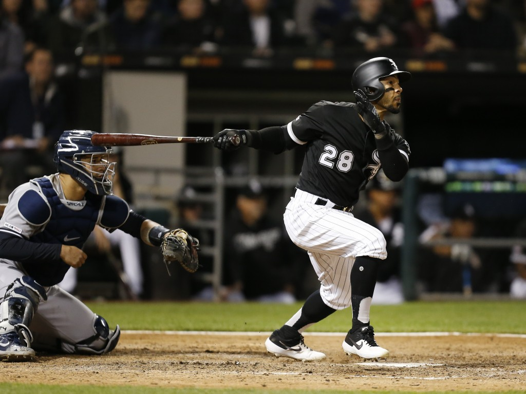 Chicago White Sox's Leury Garcia watches his solo home run against the New York Yankees during the seventh inning of a baseball game Thursday, June 13...