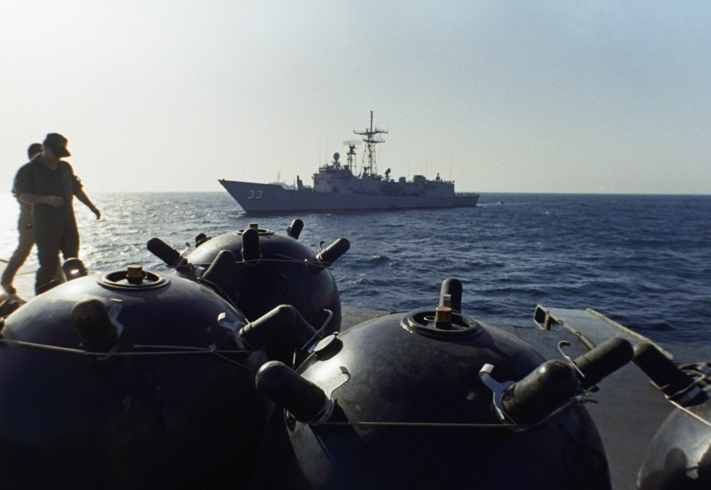 FILE - This Sept. 21, 1987 file photo shows mines aboard the Iranian ship Iran Ajr being inspected by a boarding party from the USS Lasalle in the Per