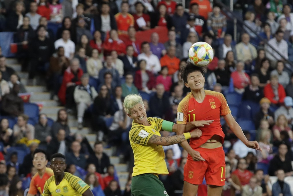 China's Wang Shanshan, right, goes for a header with South Africa's Janine Van Wyk during the Women's World Cup Group B soccer match between China and