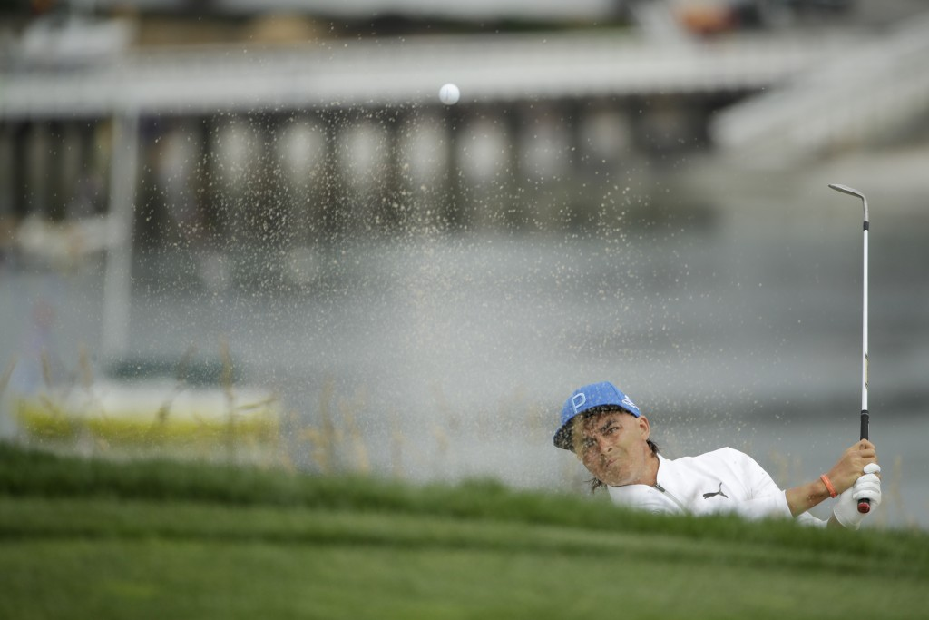Rickie Fowler hits out of the bunker on the sixth hole during the first round of the U.S. Open Championship golf tournament Thursday, June 13, 2019, i
