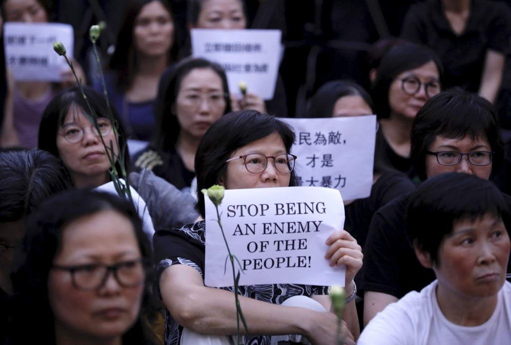 Hundreds of mothers protest against the amendments to the extradition law after Wednesday's violent protest in Hong Kong on Friday, June 14, 2019. Cal