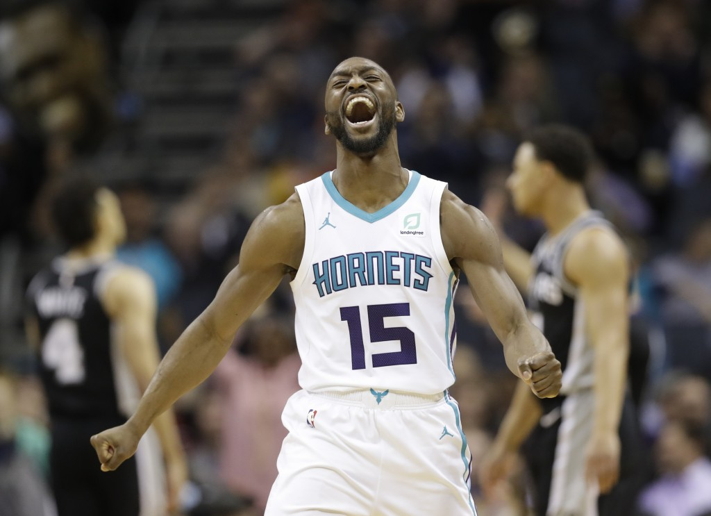 FILE - In this March 26, 2019, file photo, Charlotte Hornets' Kemba Walker (15) reacts after making a basket against the San Antonio Spurs during the