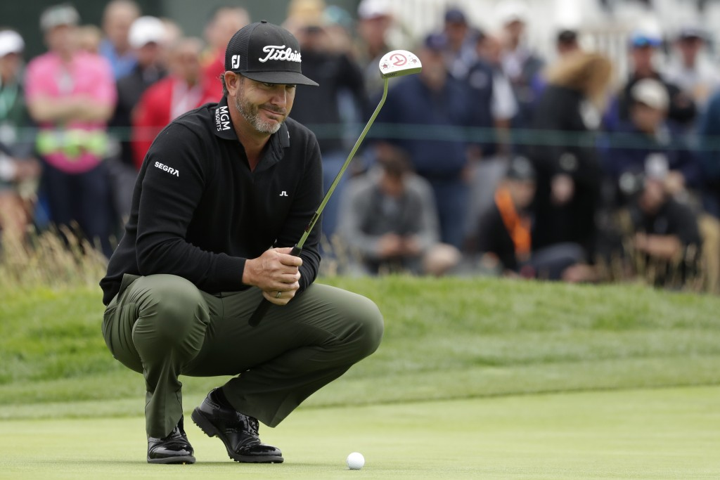 Scott Piercy lines up a putt on the 18th hole during the first round of the U.S. Open Championship golf tournament Thursday, June 13, 2019, in Pebble