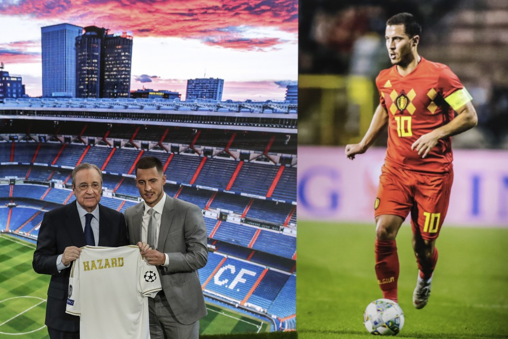 Belgium forward Eden Hazard, right, holds his new shirt with Real Madrid's President Florentino Perez during his official presentation after signing f