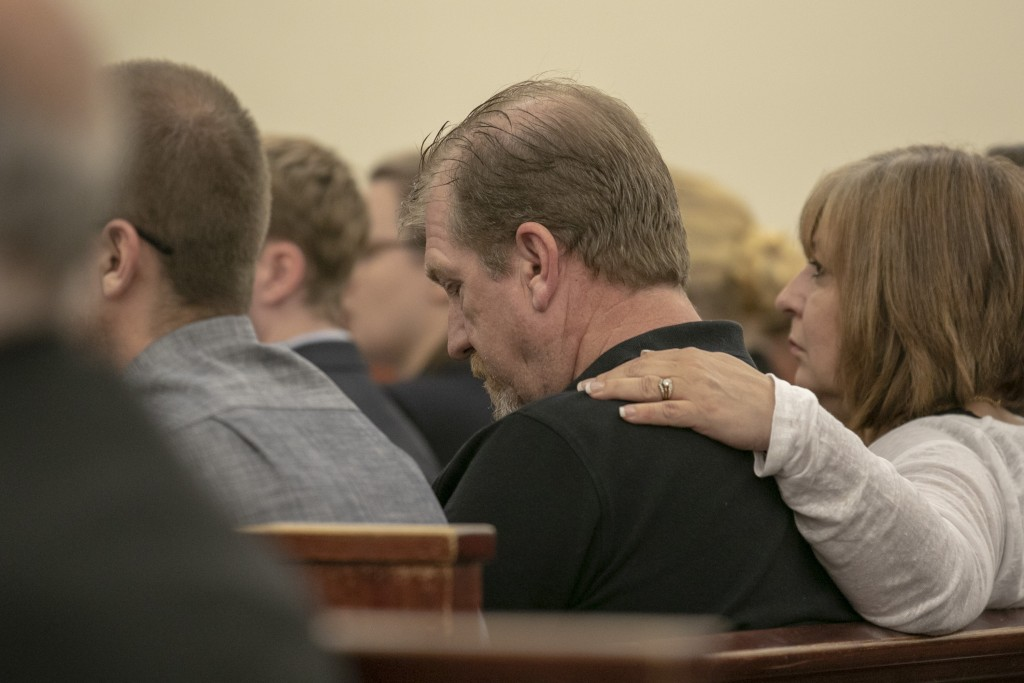 Tim Jones Sr., and his wife, Julie Jones listen as 11th Circuit Solicitor Rick Hubbard delivers closing arguments, pushing for the death penalty, duri