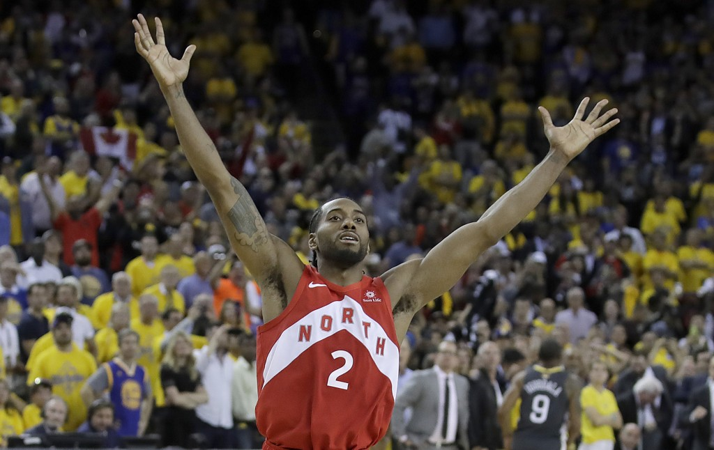 Toronto Raptors forward Kawhi Leonard celebrates after the Raptors defeated the Golden State Warriors in Game 6 of basketball's NBA Finals in Oakland,...