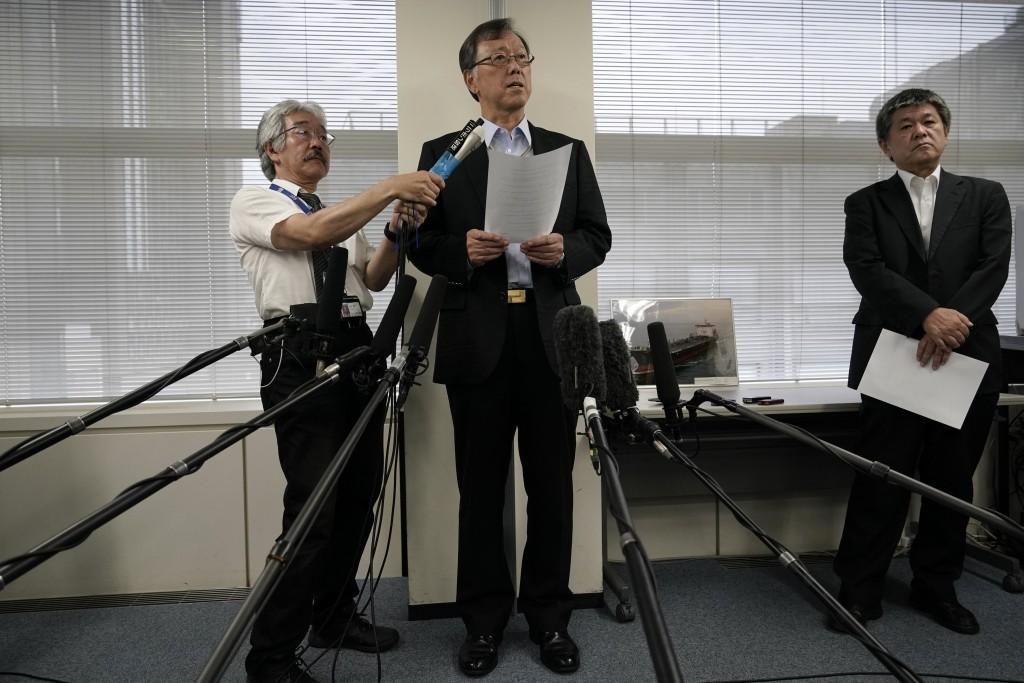 Yutaka Katada, center, president of Kokuka Sangyo Co., the Japanese company operating one of two oil tankers attacked near the Strait of Hormuz, talks