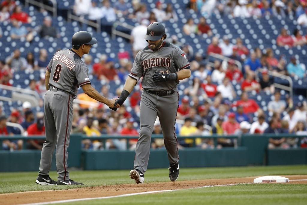 Arizona Diamondbacks' Alex Avila, right, rounds the bases past third base coach Tony Perezchica after hitting a solo home run during the second inning...