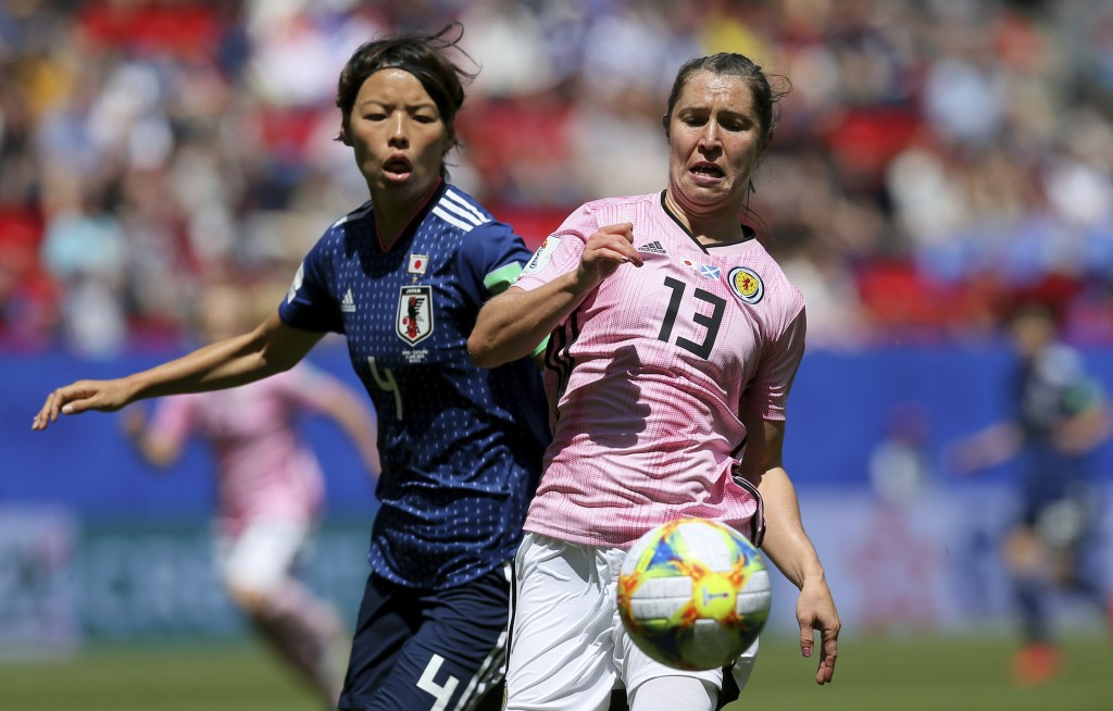 Scotland's Jane Ross, right, is challenged by Japan's Saki Kumagai during the Women's World Cup Group D soccer match between Japan and Scotland at the
