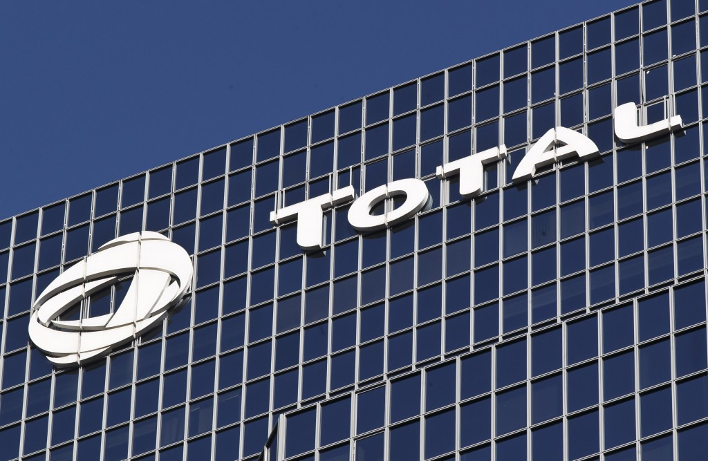 FILE - In this Jan.11, 2016 file photo, the logo of French oil giant Total SA is pictured at its headquarters in La Defense business district outside