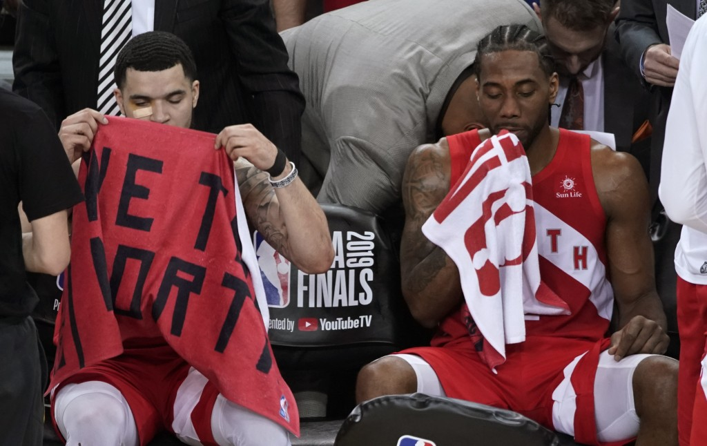 Toronto Raptors guard Fred VanVleet, left, sits on the bench next to forward Kawhi Leonard during the second half of Game 6 of basketball's NBA Finals