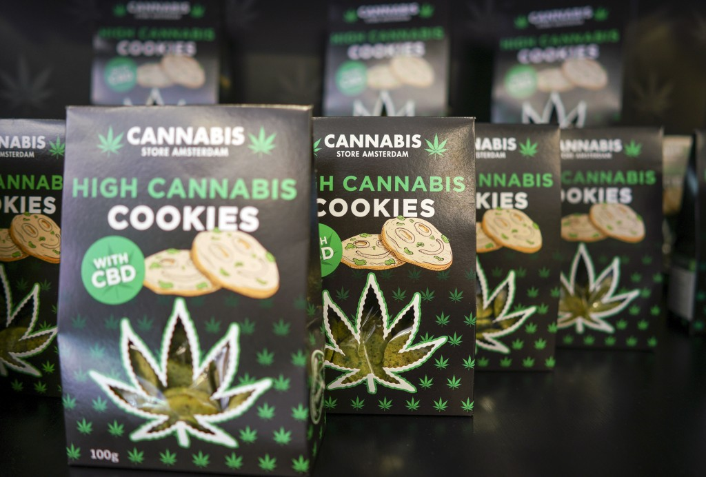 In this Thursday, June 6, 2019 photo, boxes of cookies are on sale at a Cannabis light store in Rome. It's been called Italy's ''Green Gold Rush,'' a ...