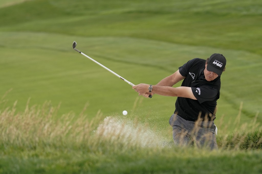 Phil Mickelson hits out of the bunker on the 10th hole during the first round of the U.S. Open Championship golf tournament Thursday, June 13, 2019, i