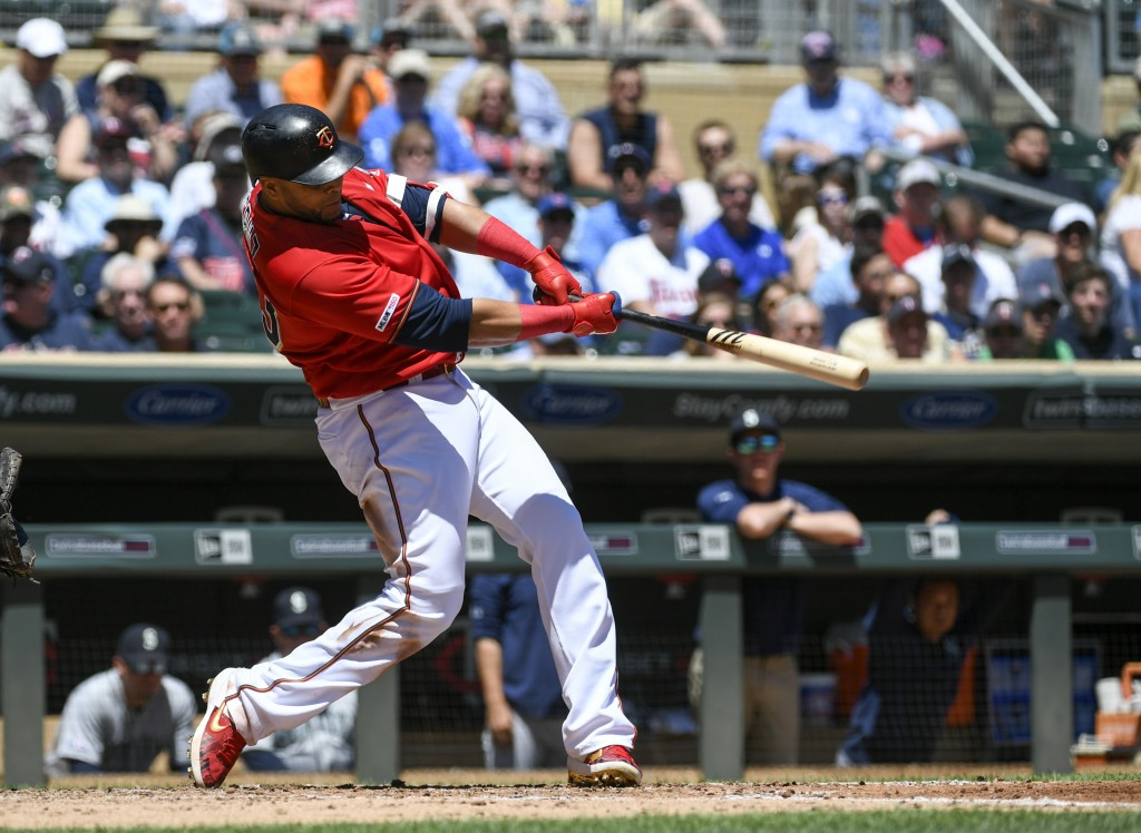 Minnesota Twins designated hitter Nelson Cruz hits a solo home run off a pitch by Seattle Mariners pitcher Yusei Kikuchi during the third inning of a
