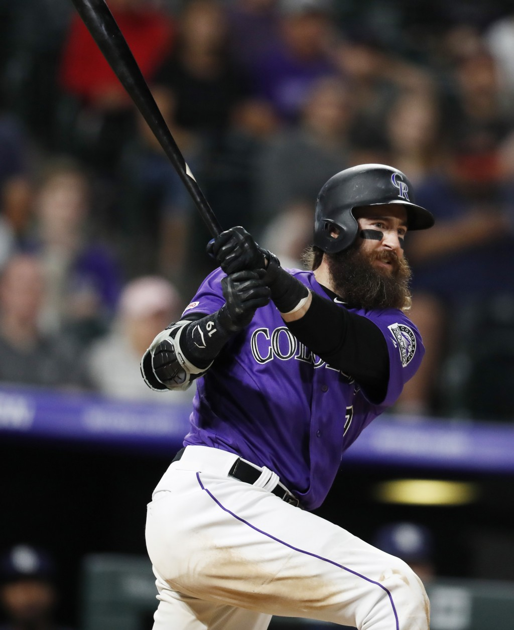 Colorado Rockies' Charlie Blackmon watches his two-run triple off San Diego Padres starting pitcher Matt Wisler during the seventh inning of a basebal