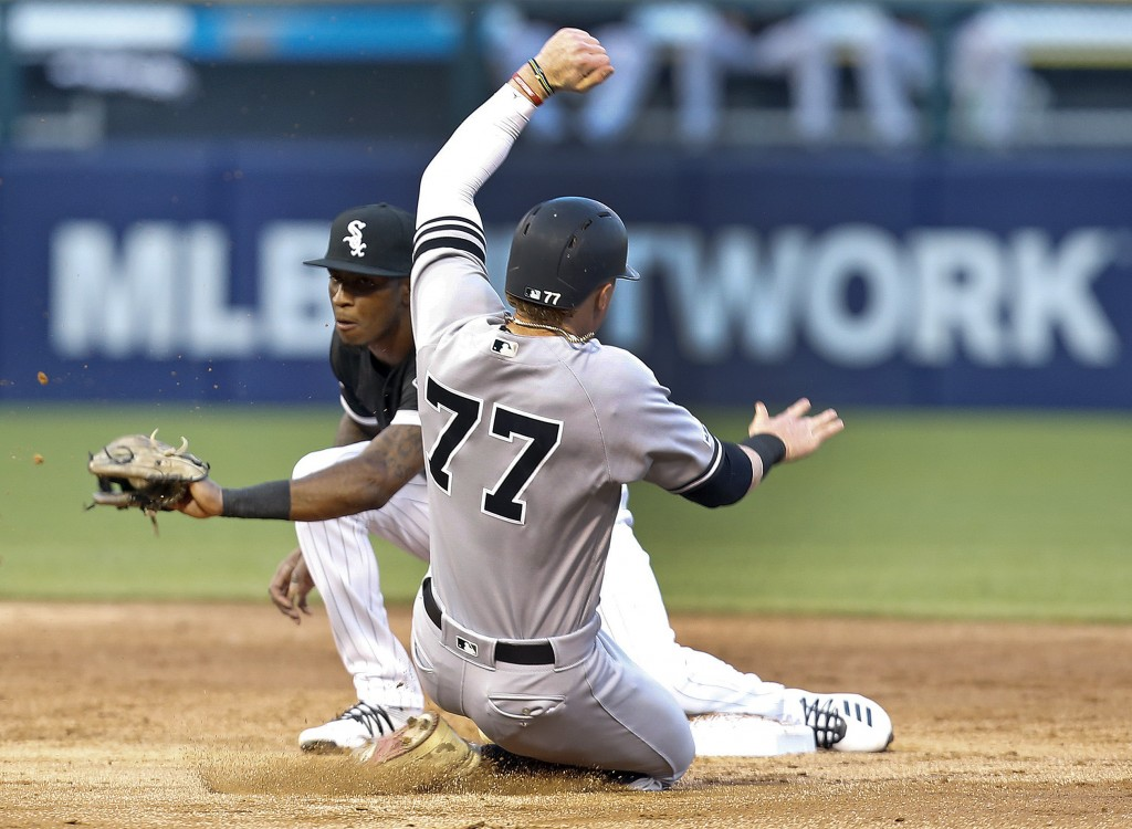 New York Yankees' Clint Frazier is caught stealing second base by Chicago White Sox shortstop Tim Anderson during the second inning of a baseball game...
