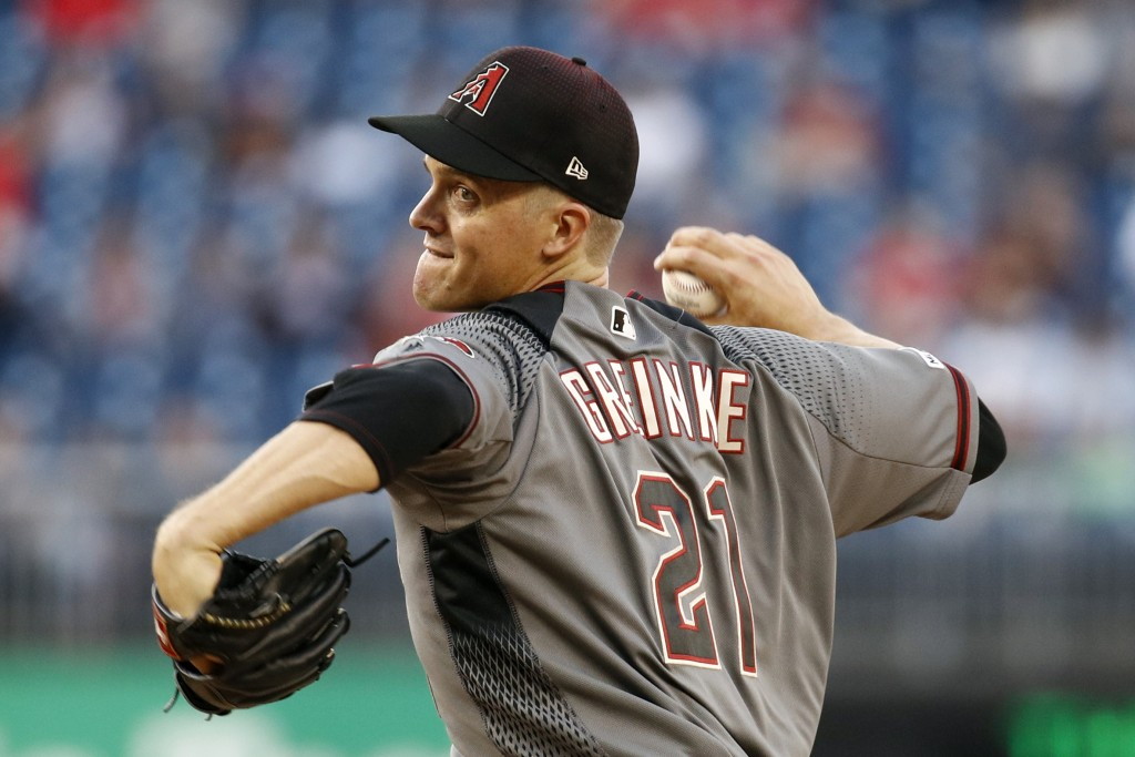 Arizona Diamondbacks starting pitcher Zack Greinke throws to a Washington Nationals batter during the second inning of a baseball game Thursday, June