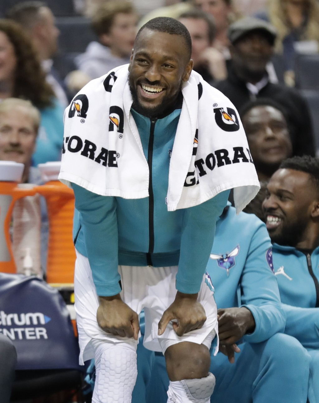 FILE - In this March 26, 2019, file photo, Charlotte Hornets' Kemba Walker laughs at a play from the bench during the first half of an NBA basketball