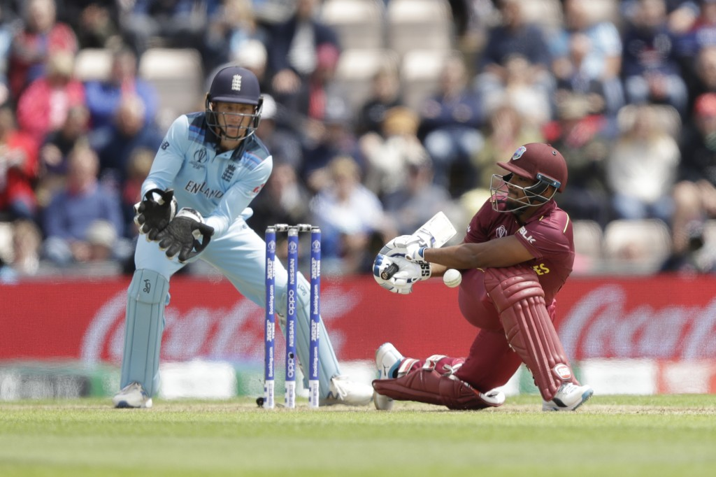 West Indies' Nicholas Pooran fails to connect with a hit during the Cricket World Cup match between England and West Indies at the Hampshire Bowl in S...