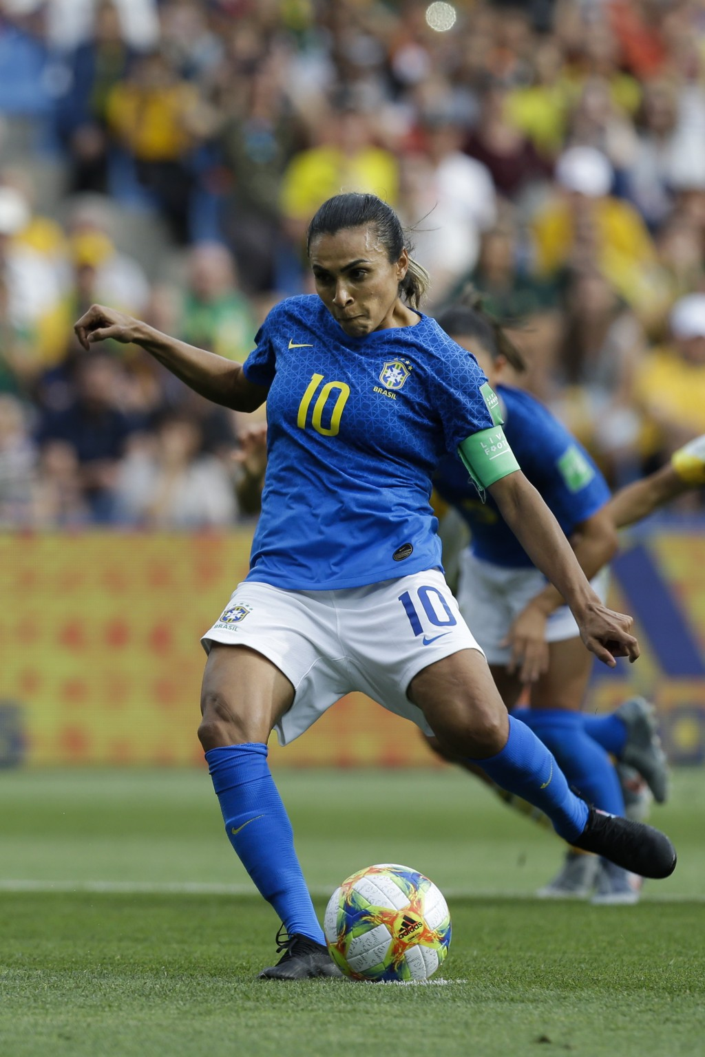 Brazil's Marta shoots a penalty kick to score the opening goal during the Women's World Cup Group C soccer match between Australia and Brazil at Stade
