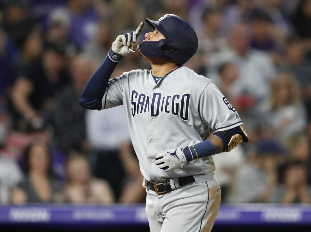 San Diego Padres' Manny Machado gestures after hitting a solo home run off Colorado Rockies starting pitcher Jon Gray during the fifth inning of a bas